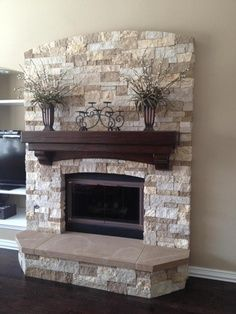 Redo:  Paint mantle darker, whitewash our brick to a light gray/white. So our mantle is light, maybe stain or paint our brick on the darker browns variegated side.