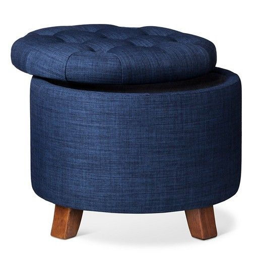 Mid-century cool is yours with the vintage-inspired Threshold.  Tufted Round Storage Ottoman. This sharp piece of home furniture invites you to kick up your heels and relax in style with its plush button-tufted cushion and nostalgic design.  Featuring a durable hardwood frame, contemporary tapered feet, attractive linen upholstery and a nifty hidden storage compartment accessible with just a lift of the seat.
