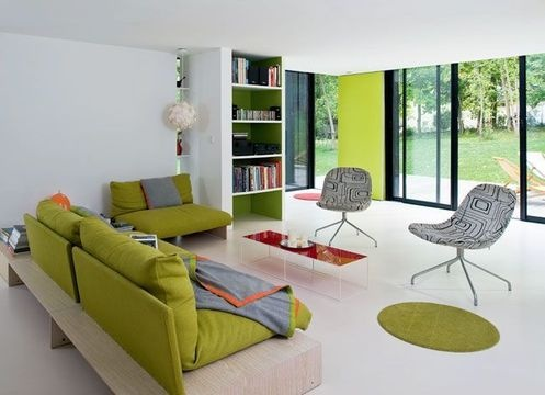 Living room with green sofas