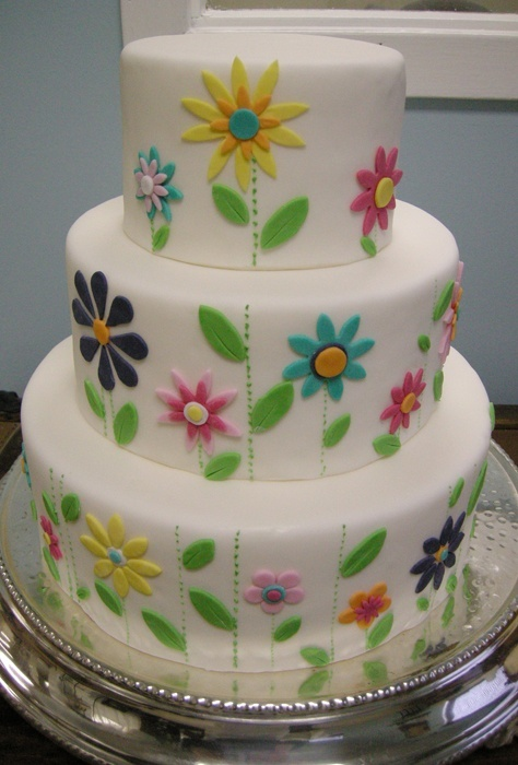 Love this look. Whimsical flower cake.  Paint these flowers on the wall?