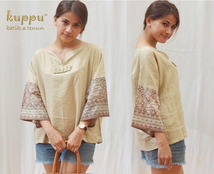 TOP LINEN CREAMY... LINEN BATIK TOP - CREAMY  by: Kuppu Batik & Tenun  680.000,00  Italian 100% cotton linen, combined with natural-dye Batik Tulis from Solo, Central Java, Linen colour: creamy Loose M/L size: Bust 120cm, Arm 50cm, 58cm long from highest shoulder point Dry clean or hand wash with mild soap only - hang to dry, avoid direct sunlight - low heat iron on tenun part. Do not use washing machine.  www.kuppubatiktenun.com  Laura 08119103668 Pin BB 751E6162