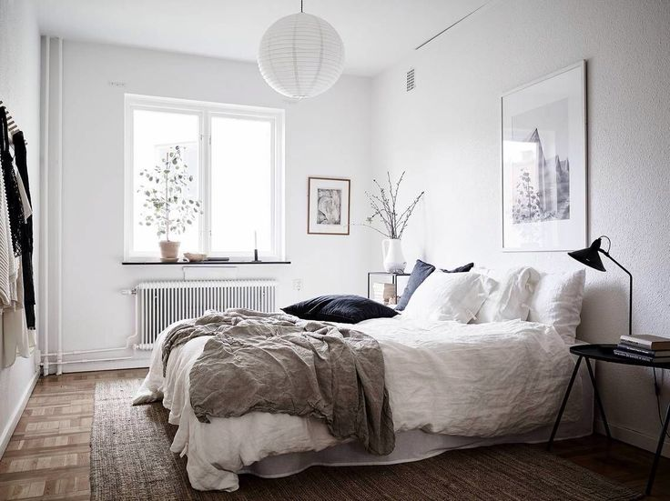 i like the warm look and feel of this small home the white furniture combined with wood accent pieces and the wooden floor make this place look very