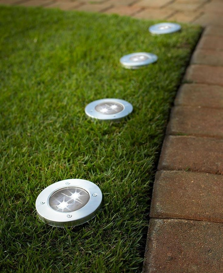 Show the way through your yard at night with this Set of 4 Solar Pathway Garden Lights. Each easily stakes into the ground and contains 2 bright LEDs. A stainle