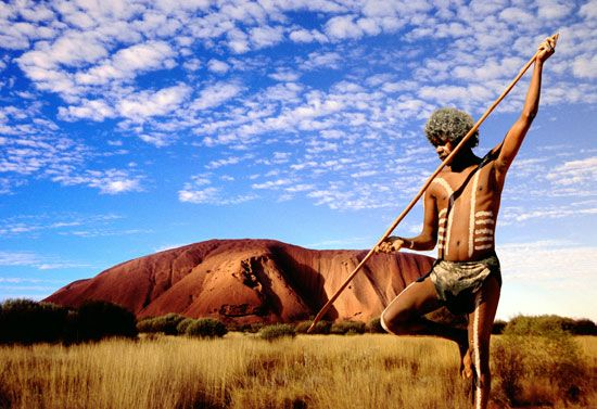 Aboriginal Warrior, Uluru (also known as Ayers Rock), Uluṟu-Kata Tjuṯa National Park, Australia;