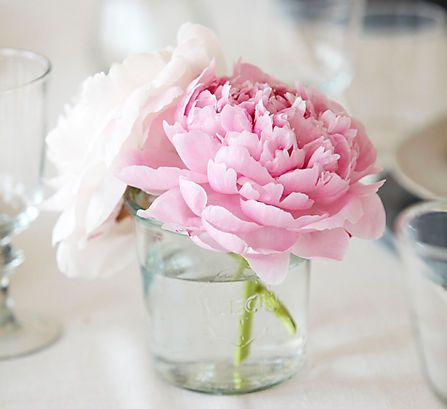 Unexpected Vases Inexpensive jam jars by Weck were used for the table's floral arrangements, setting a casual tone without losing an ounce of charm. Mason jars would be a stylish stand-in.