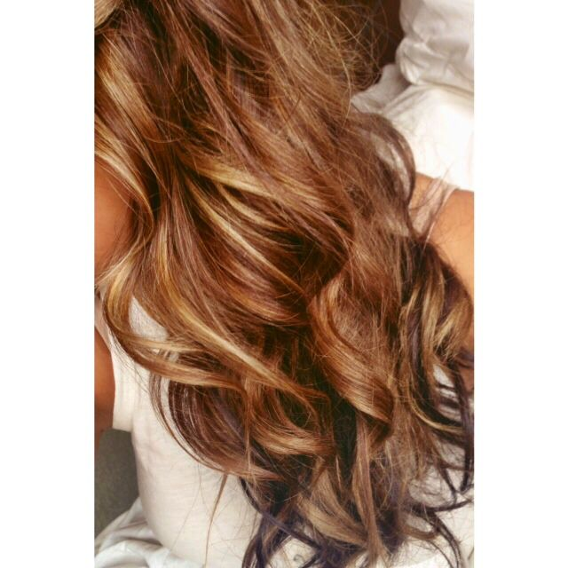 Light brown hair with caramel highlights.
