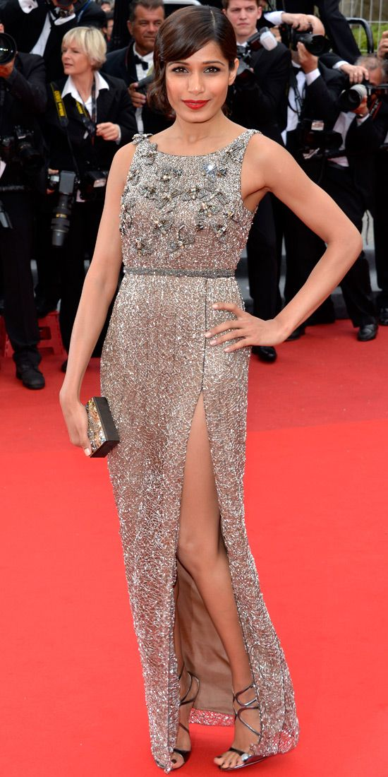 Freida Pinto sparkled on the Cannes red carpet in an embroidered column, pearl Daniel Swarovski box clutch and strappy sandals.