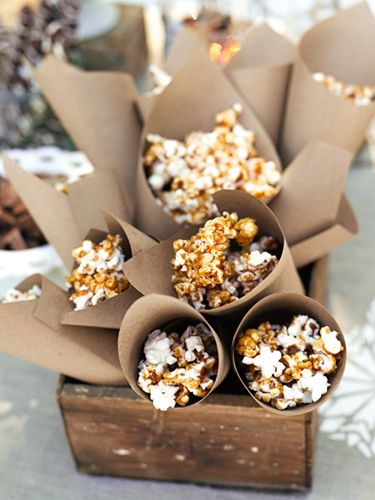 The secret to this salty-sweet snack? Ready-made caramel syrup, melted and drizzled over popcorn. Serve it in Kraft-paper cones. #partyideas