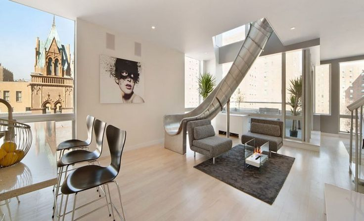 When it comes to cool house features, what is more fun (and frivolous) than a house decked out with an indoor slide?