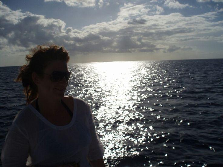 Momento relax yendo en catamarán en Punta Cana. Rep Dominicana/ Relaxing moment traveling by Katamaran. Punta Cana. Rep. Dominicana