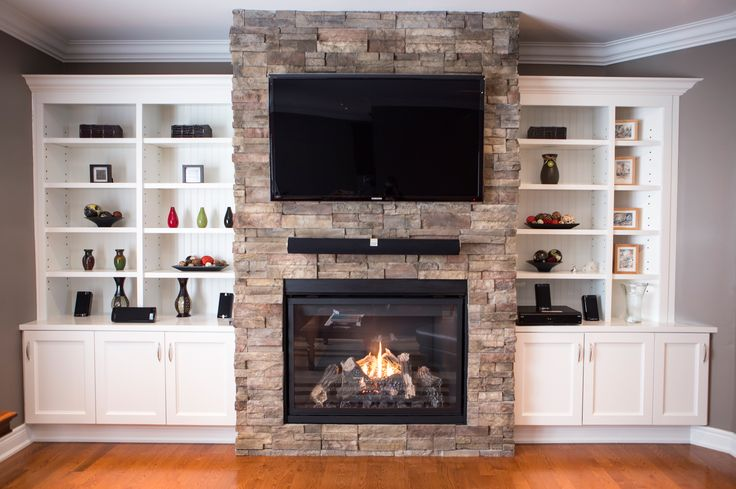 Built In Units On Either Side Of The Fireplace