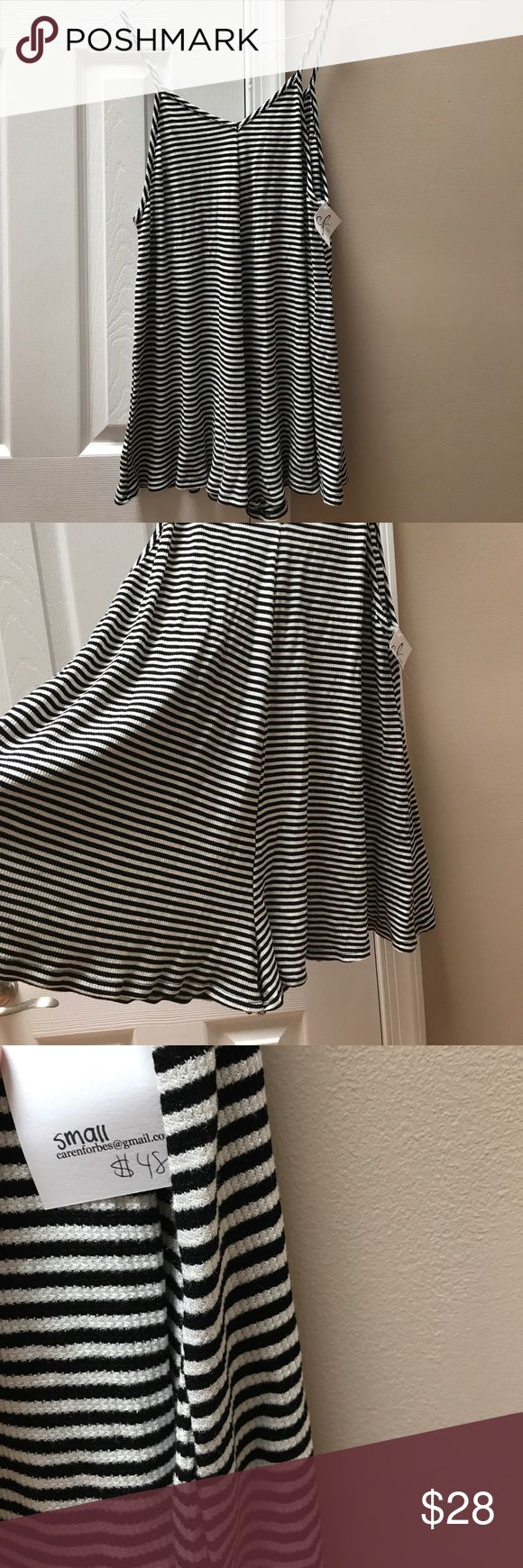 Caren Forbes jumper size small This black and white romper had thing spaghetti straps. Light soft material. 95% rayon 5% spandex. Other