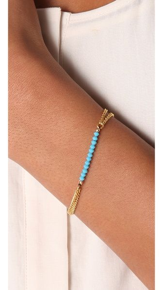 This gold double-chain bracelet features Swarovski crystal beads. Adjustable length
