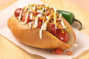 Wrapped in bacon and topped with HEINZ BBQ sauce, green onions and shredded cheese, these hot dogs have a delicious down-home appeal.