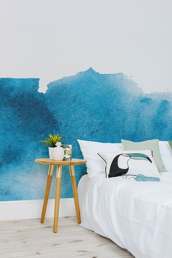 Love tropical interiors? This blue watercolour wallpaper design is the ultimate backdrop to laid-back and calming bedroom spaces. Create your own little oasis with this stylish design.