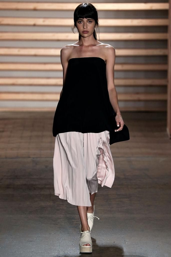 Tibi Spring 2015: Black silk strapless trapeze top with blush pleated silk culottes and ivory flatforms.