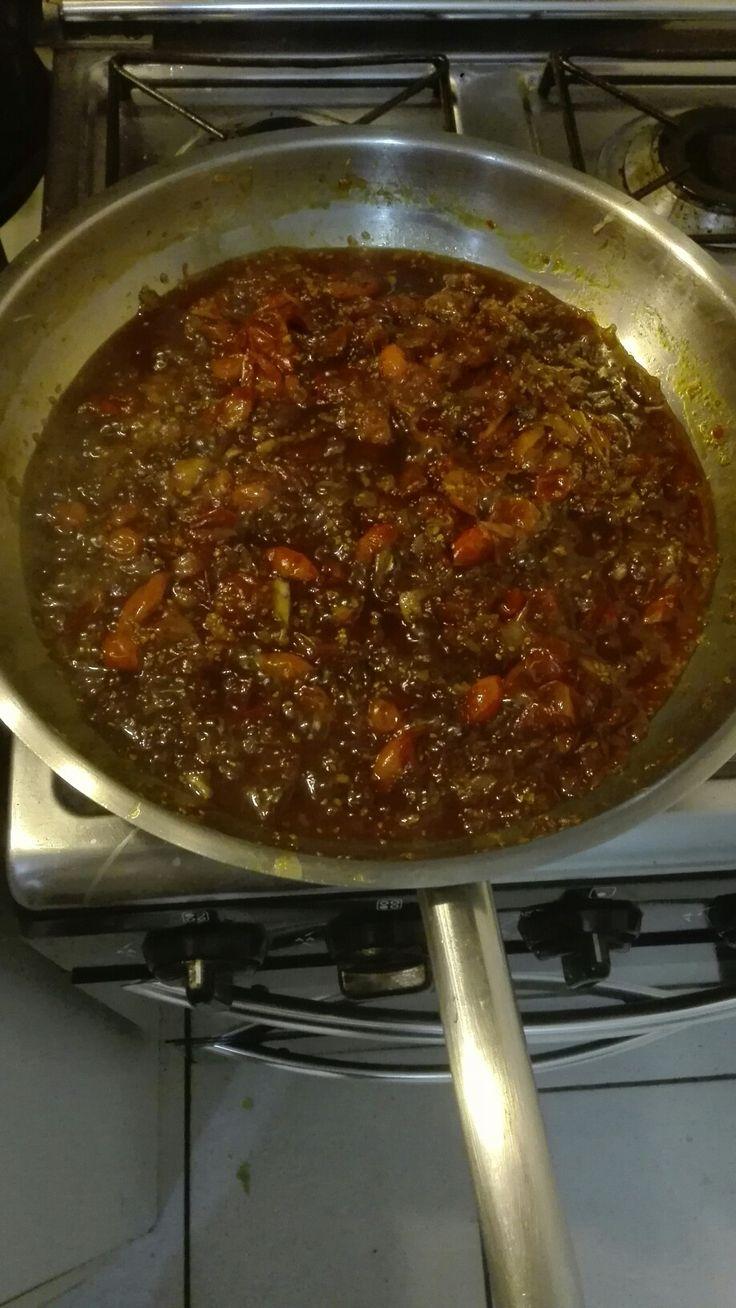 Tomato chilli jam in the making