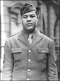 """Boxing Legend T/Sgt Joe Louis US Army (Served 1942-1945) Short Bio: Although Louis never saw combat, his military service would see challenges of its own. During his travels he would often experience blatant racism. On one occasion, a military policeman (MP) ordered Louis and Ray Robinson to move their seats to a bench in the rear of an Alabama Army camp bus depot. """"We ain't moving,"""" said Louis. The MP tried to arrest them, but Louis forcefully argued the pair out of the situation."""