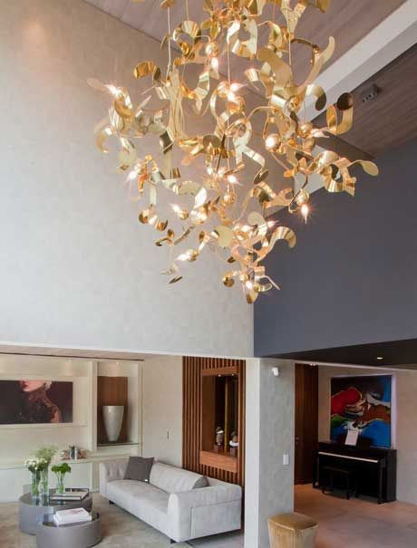 Contemporary luxury chandelier kelp in a brass finish interior project by estudio jorge fuentes our high end designer lighting of over 30 modern