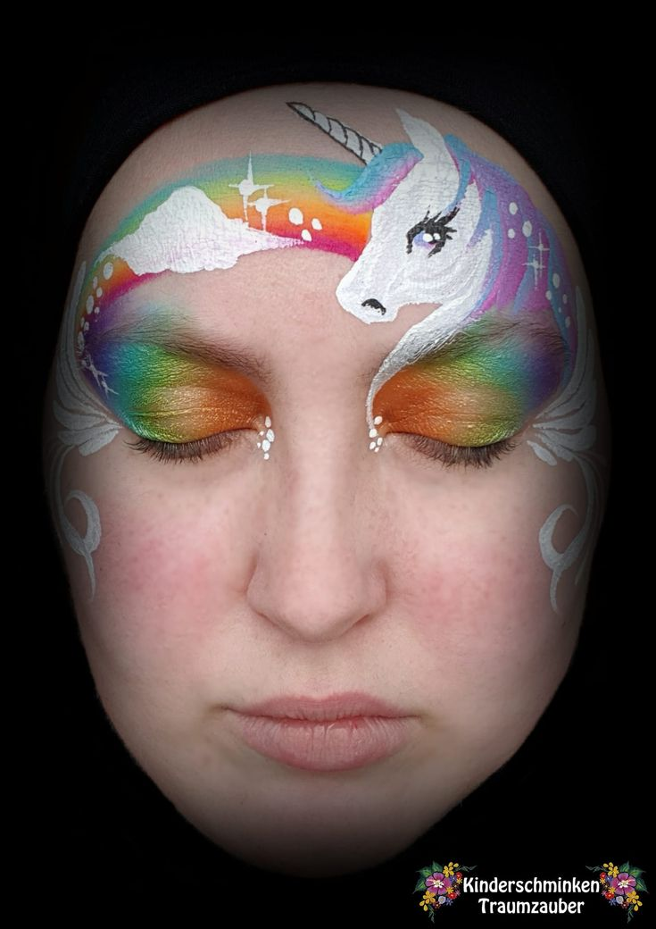 Unicorn Rainbow face paint from Kinderschminken Traumzauber. Love the placement and the cloud.