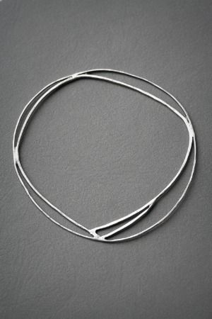 simple silver bangle by Courtney Filer-Dougal - would look even better as a neckpiece, no?