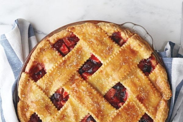 Fresh cranberries give classic apple pie a special kick of tartness that elevates our apple and cranberry lattice pie recipe. A must-try dessert for your next Sunday supper! Photo by Jeff Coulson.