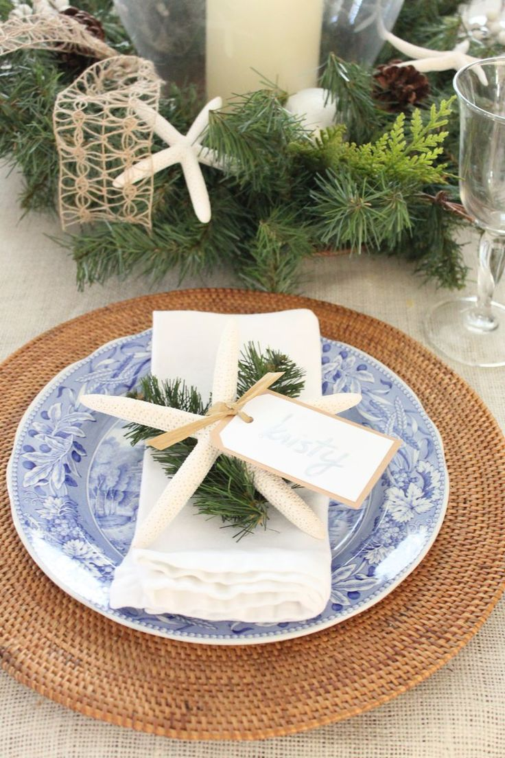 A blue and white coastal Christmas table setting. http://kristyseibert.com/blog/2014/12/blue-and-white-christmas-table-setting.html