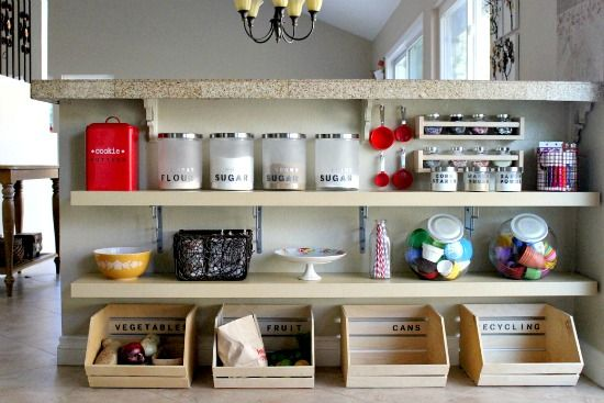 If you aren't getting any use out of something in your kitchen, take a cue from Create Celebrate Explore and utilize it for extra storage, like this unused breakfast bar turned pantry... I think I would use it for dish storage instead of food... But great idea!