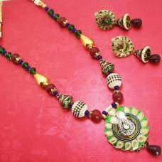 The pendant is made up of copper polished in high gold and covered in meenakari / enameling in multiple colors