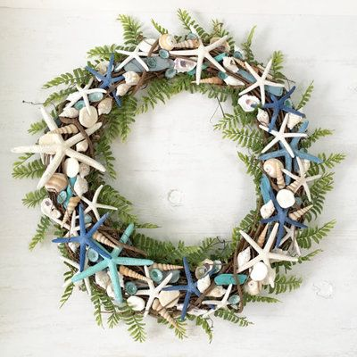 Coastal Wreaths: Here, the best of both worlds—a little bit of green and beach! We love the way these ferns play sweetly with starfish and shells. | CoastalLiving.com