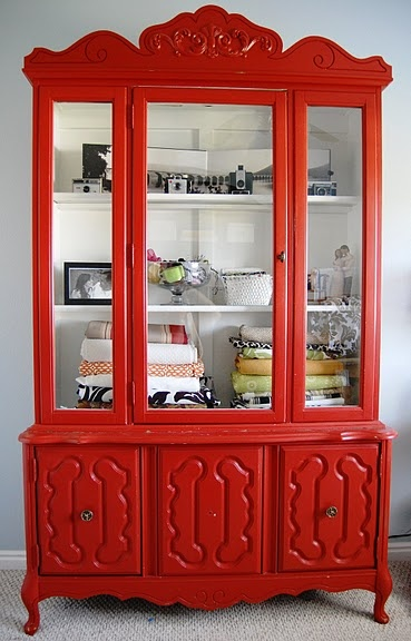 adorable red hutch! The blogger here is using this in her craft room - wouldn't have thought of doing that myself.