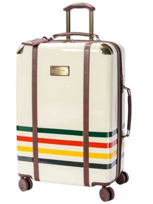 Love what feels like the vintage leather luggage straps wrapped around the bag. | Glacier Stripe Spinner Luggage by Pendleton.
