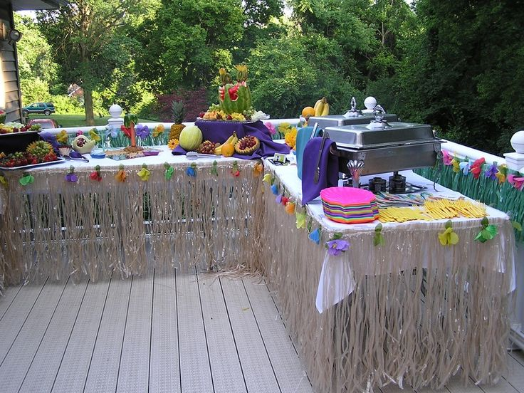 Grass skirts for the tables? menu for luau theme party | Luau Wedding Reception
