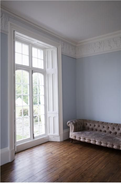 Farrow and Ball. Lounge with walls in Skylight Estate Emulsion, woodwork in Wimborne White, detailing in Strong White Soft Distemper and ceiling in All White Estate Emulsion.