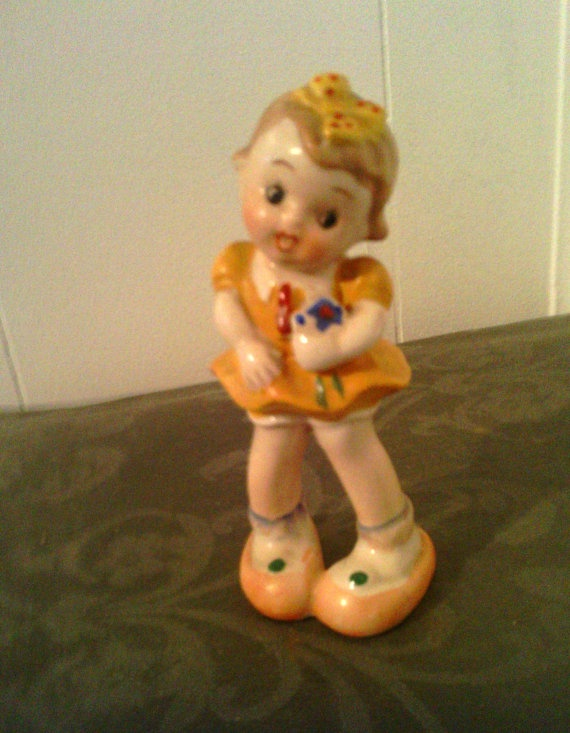 Small collectible vintage hummel like girl in yellow dress for Vintage sites like etsy