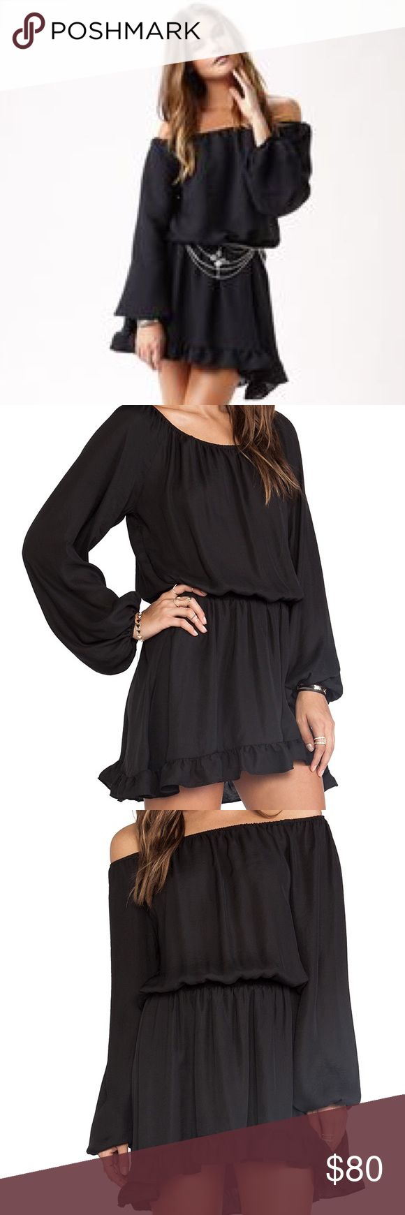 Show Me Your Mumu Black Lee Lee Ruffle Dress Flawless condition. Lee Lee Ruffle Dress is a work hard play hard kinda gal. Her girly glam adds instant charm to your wardrobe. Wear her over the shoulders or pull her elastic scrunch band across your arms to show a little more skin. Show Me Your MuMu Dresses Mini