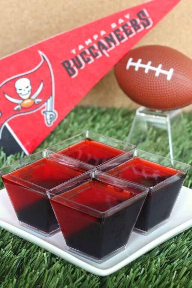 Tampa Bay Buccaneers Jell-O Shots (3 1/2 Tbs grape Jell-O powder 3 1/2 Tbs lime Jell-O powder 2 envelopes plain gelatin 2 cup vodka 3 oz. cherry Jell-O)