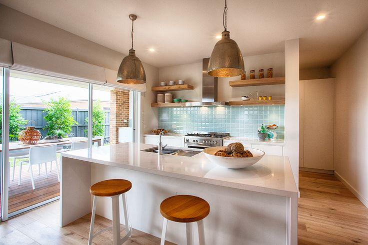 Modern and beachy kitchen with alfresco