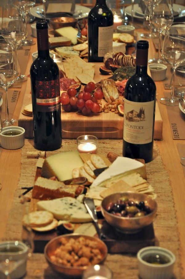 abundant spread of cheeses, meats, bread, wine and olives became the centerpiece. All you need to complete this, other than the gourmet ingredients, is oversized wooden cutting boards, pretty little bowls and cheese knives.