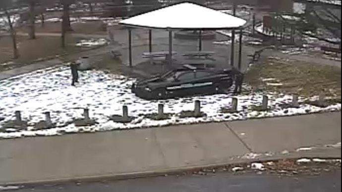 A police officer (L) is seen pointing his weapon during an incident involving the shooting of a 12-year-old boy with a pellet gun at the Cudell Recreation Center in Cleveland, Ohio, in this still image from video released by the Cleveland Police Department November 26, 2014. (Reuters/Cleveland Police Department)