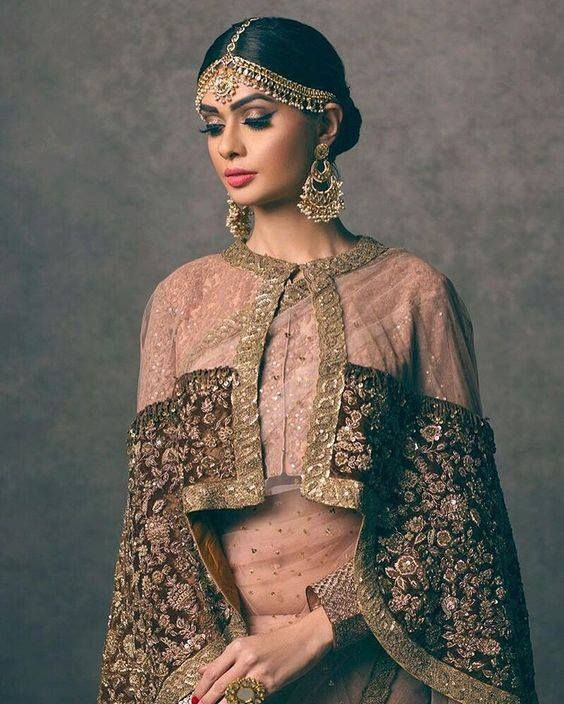Lehenga with a cape! #trending #weddingseason To see more: http://www.functionmania.com/blog/unique-outfit-styles-modern-indian-bride-minimalist-fashion-trend/
