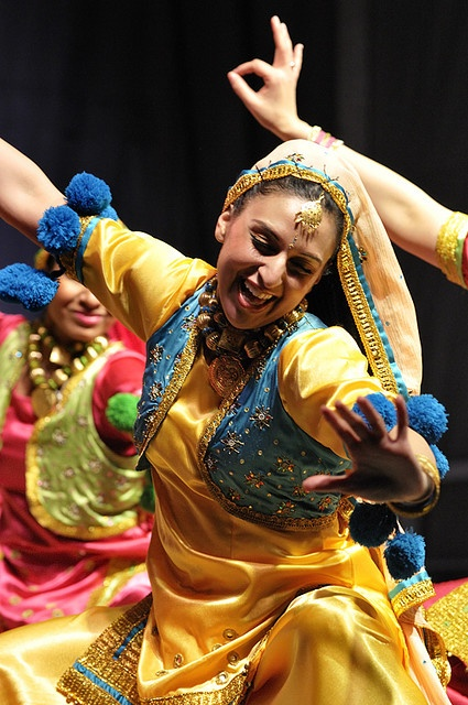 Indian dance.  love the sheer joy on this lady's face