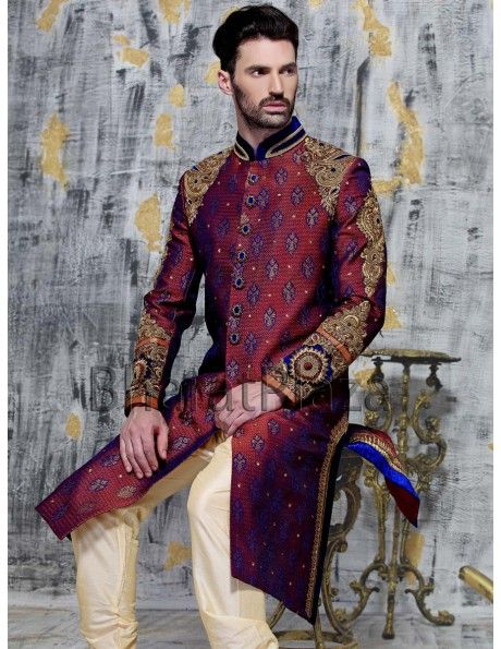 Imperious maroon color brocade sherwani is having gleaming diamantes, bullion, sequins, beads work shoulder and sleeves, decorative buttons and contrast velvet patch collar is pleasing appearance. Comes with cream color churidar. Make your celebration unique with this stunning ensemble.