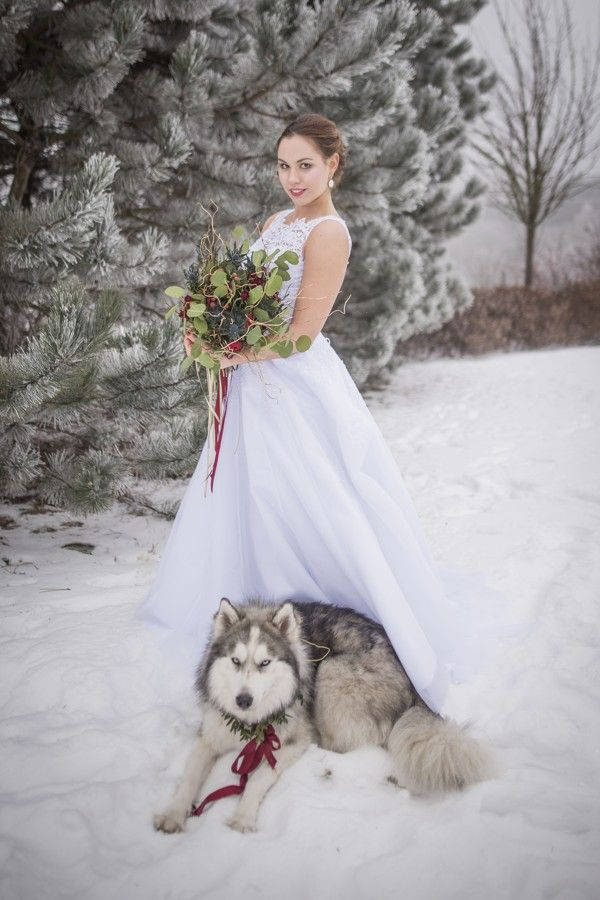 Winter wedding in the woods with eucalyptus and thistles bouquet.