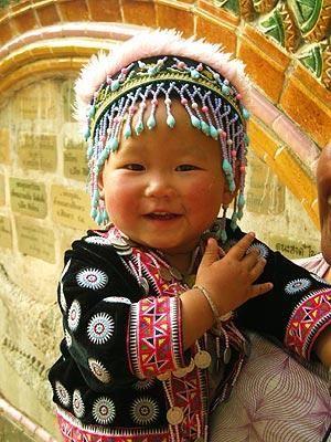 A little girl wears minority dress in Thailand.