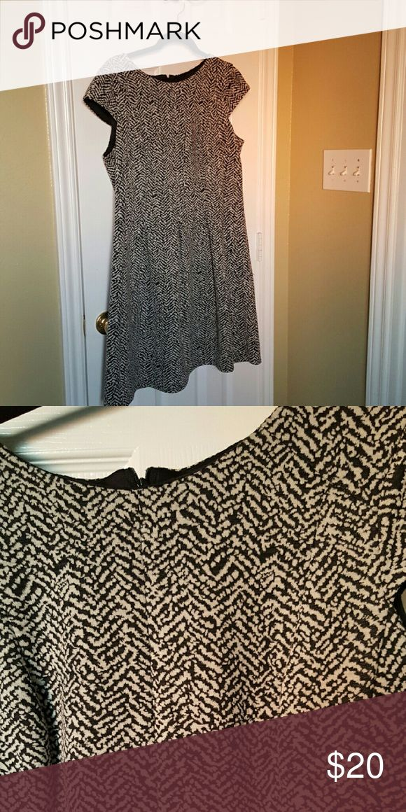 Stretchy black and white work dress Discreet pleats at waist,  stays away from mid section.  Looks great with black tights. AB Studio Dresses Midi