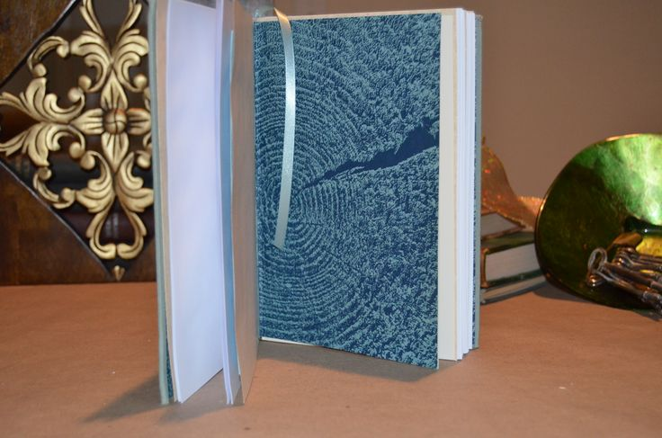 """Handcrafted """"Writer's Pages"""" journal, with light blue satin ribbon bookmark, premium white paper, and original book element retained. Gorgeous!"""