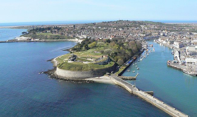 Aerial view of the Nothe Fort, Weymouth harbour and the town.