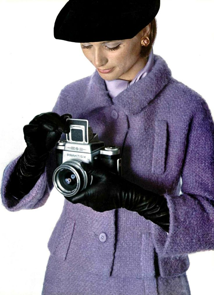 Model in lilac wool-mohair suit by Lanvin-Castillo, photo by Pottier, 1964 purple dress bucle 60s fashion style color photo print ad lavender black gloves hat camera