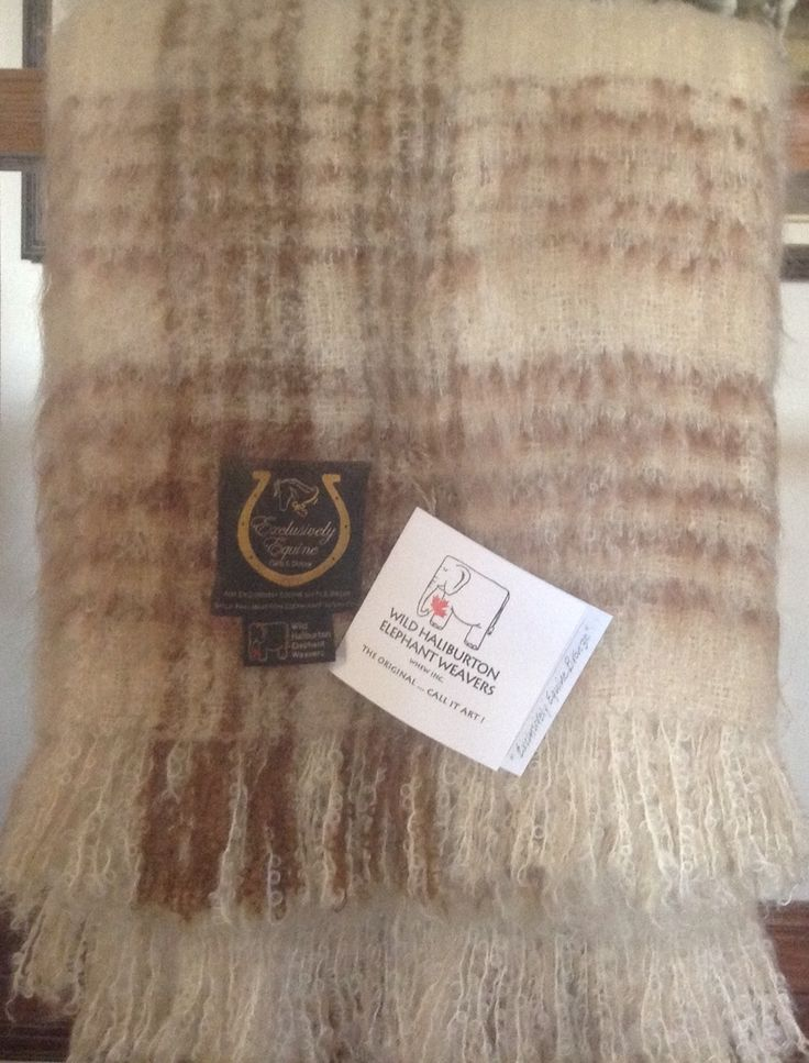 Exclusively Equine Pattern Kid Mohair Throw – Bronze.  The quality of this throw is like non-other, incredibly soft & luxurious! This equestrian plaid pattern is exclusive to Exclusively Equine Gifts & Decor with lovely bronze, beige and brown tones.